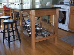 free standing kitchen island with seating i built this island as a freestanding table with an open shelf