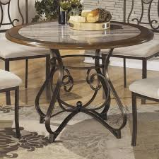 signature design by ashley tilley round dining room table with