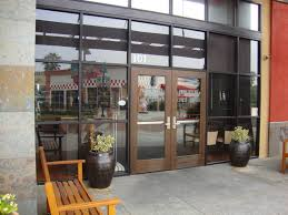 store front glass doors storefronts u2014 orange mirror and glass