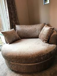 next swivel cuddle chair in light mink crushed velvet in crawley