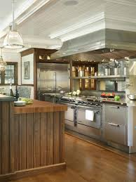 stainless kitchen cabinet appliances brown wooden kitchen island exposed brick wall cool