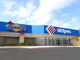 sunoco selling stores to 7 eleven