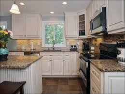 off white kitchen cabinets with stainless appliances off white kitchen cabinets with slate appliances trekkerboy