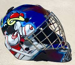 an article about the growth of masked marvel goalie helmets