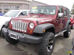 dark gray jeep 2010 jeep wrangler unlimited sport 4x4 in red rock crystal pearl