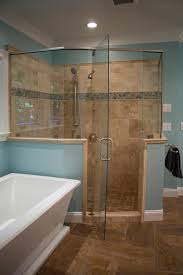 Blue And Brown Bathroom by This Light Blue Master Bathroom Features A Spacious Glass Enclosed
