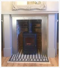 black u0026 white victorian tile fireplace hearth u2014 mosaics by post