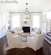 the lovely brass floor lamps in this inviting living room look