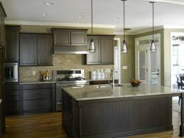 room and board pendant lights brownish gray cabinets wooden flooring granite countertop single