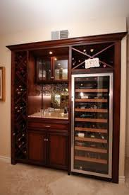 built in wine bar cabinets i like the wine storage not in white but i like the idea of it