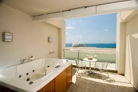 adenya hotels resorts select oda hidden lighting in bedrooms and bathrooms bedside control panel for lights large illuminated wardrobe bathtub in the bathroom wc