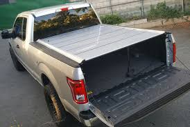 paragon retractable aluminum tonneau cover clamp mount option i purchased shorter 5 16 bolts to adjust the ramps as the ones supplied were too long and dangerously pertrusive on my 2016 xlt 6 5ft bed no problem