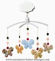 carillon da culla per culla musicale animata trousselier con farfalle e stelle