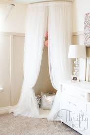 a rounded shower curtain to hang soft curtains around the crib