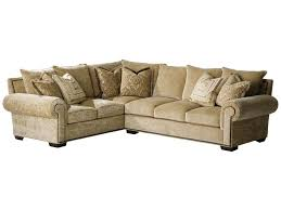 furniture l shaped sofa bed with brown cushion and round table on