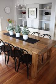 rustic rectangle wood dining table with indoor succulent planter