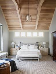 sleek bedroom design and oak wood beams with unfinished exposed