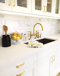 white kitchen cabinets with gold hardware white kitchen cabinets gold pulls design ideas