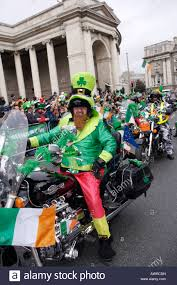 a biker dressed as a leprechaun in the st patricks day parade in