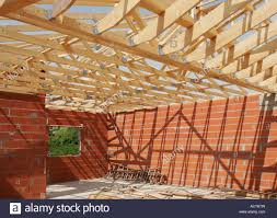 timber roof construction for a small house stock photo royalty