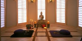 the buddha statue in group meditation room at wat umong forest