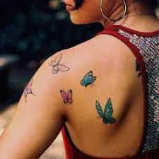 butterfly on flowers back shoulder tattoos