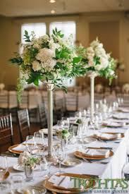 tall elegant table centerpieces that have white flowers but have