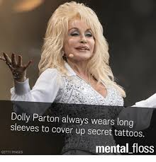 dolly parton always wears long sleeves to cover up secret tattoos
