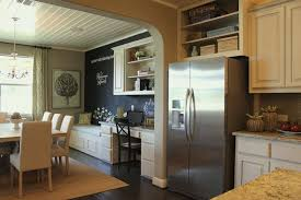 burrows cabinets kitchen with built in desk and bench seat in bone with black glaze