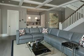 basement modern glass coffee table and gray sofa also coffered