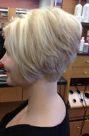 hairstyles for women over 50 with low lights short bob platinum base with golden blonde lowlights and blonde