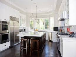 White Kitchen Cabinets Dark Wood Floors by White Cabinets Dark Flooring Kitchen Attractive Personalised Home