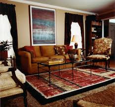 comfy gray sofa black and red living room white floral pattern rug