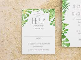 these beach wedding invitations feature a watercolor palm frond