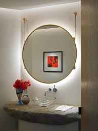 unique powder room design with huge hanging round mirror with