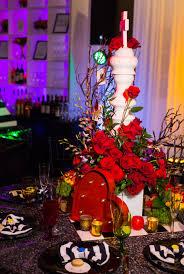 Red Roses Centerpieces Alice In Wonderland Wedding In Salvador Dali U0027s Museum Weddingomania