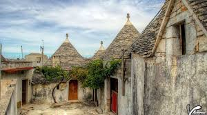 unique trulli constructed houses in alberobello italy wallpaper
