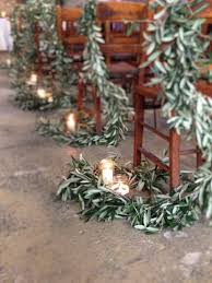 olive garland pew ends for a christmas wedding red eden and