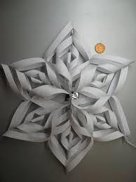 paper snowflake ornament and a larger one 8 big
