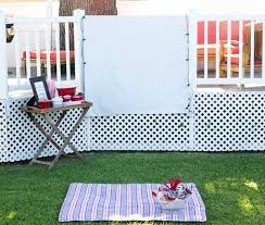How To Make A Backyard Movie Screen by Diy Outdoor Movie Night On The Cheap Thegoodstuff