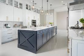 gray kitchen cabinets blue island oversize blue island in white kitchen with cabinets hgtv
