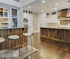 types of kitchen islands white cabinets with a walnut kitchen island masterbrand