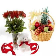 roses arranged in glass vase with cute teddy bear