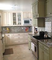rona brown kitchen cabinets pearl white cabinets with glaze seafoam green on