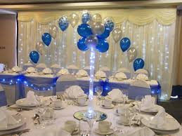 vase balloon tree in royal blue and silver with table dressing and