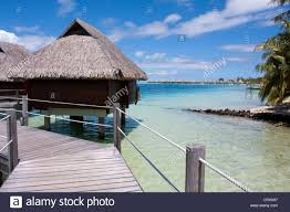 overwater bungalows on stilts at a resort hotel bora bora french