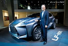lexus lf nx fukuichi executive vice president of lexus poses next to a lexus