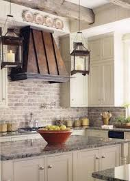 the kitchen u0027s ceiling beams were salvaged from a barn in