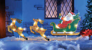 lighted santa claus sleigh and reindeer outdoor