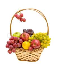 fruit in a basket still of fresh fruit in a wicker basket isolated on white